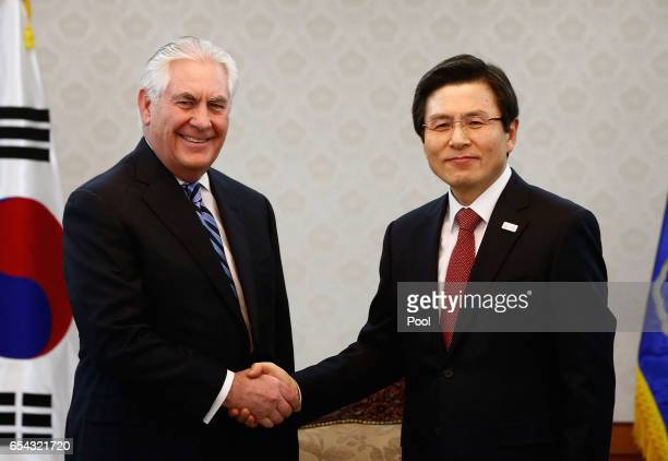 US Secretary of State Rex Tillerson shakes hands with acting South Korean President and Prime Minister Hwang Kyoahn prior to their meeting at the...