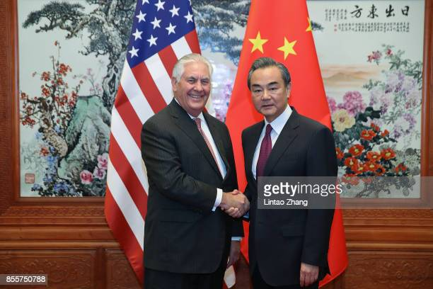 S Secretary of State Rex Tillerson shakes hands with Chinese Foreign Minister Wang Yi before their meeting at the Great Hall of the People on...