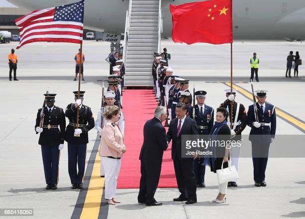 S Secretary of State Rex Tillerson shakes hands with Chinese President Xi Jinping after he arrived at Palm Beach International Airport April 6 2017...