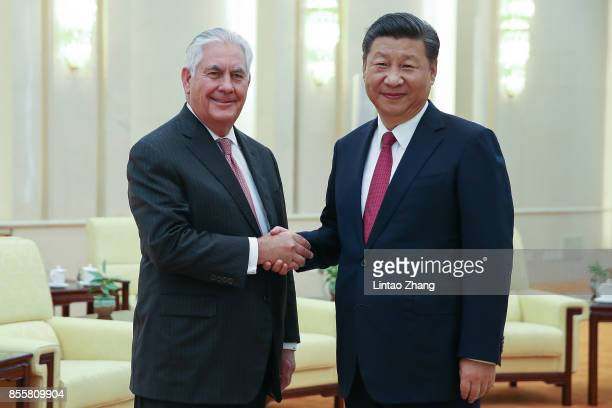 S Secretary of State Rex Tillerson shakes hands with Chinese President Xi Jinping before their meeting at the Great Hall of the People on September...