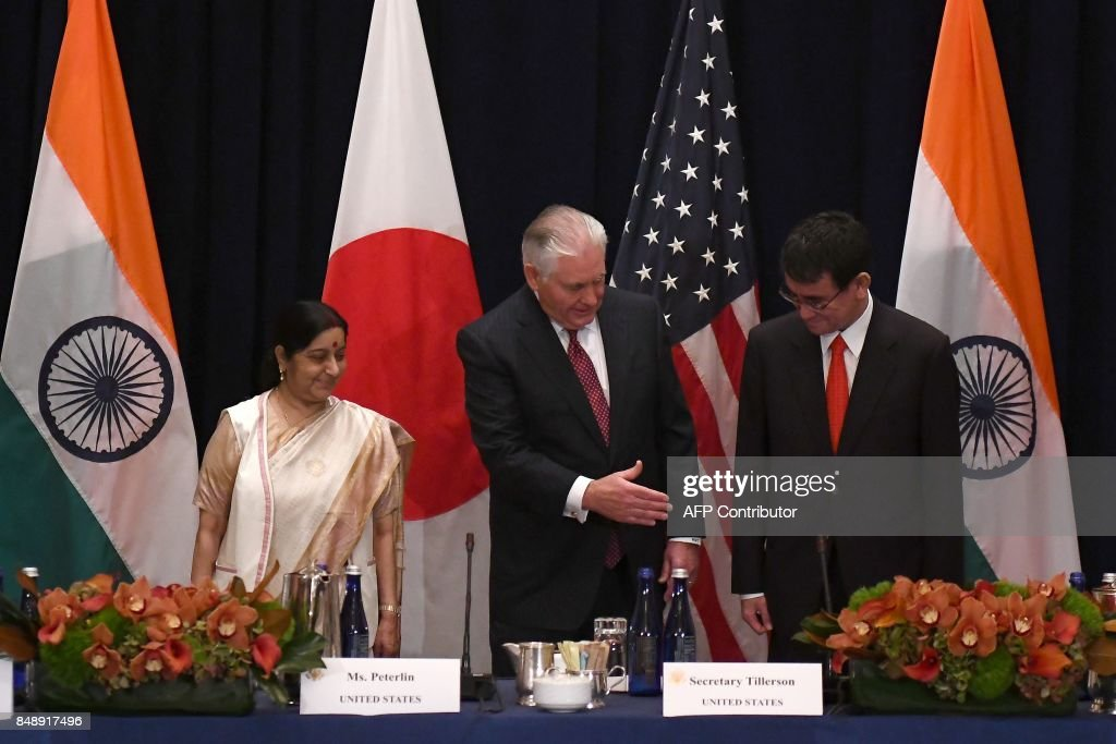 US Secretary of State Rex Tillerson (C) shakes hands with Japan's Foreign Minister Taro Kono (R) as India's Foreign Minister Sushma Swaraj looks on before a meeting on the sideline of the 72nd session of United Nations General Assembly, in New York on September 18, 2017. / AFP PHOTO / Jewel SAMAD