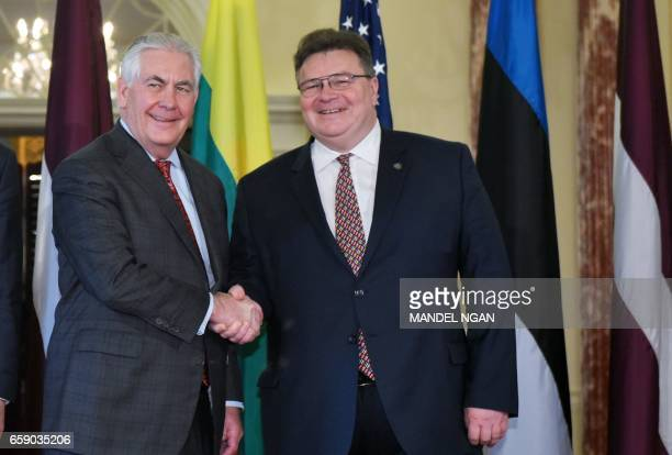 US Secretary of State Rex Tillerson shakes hands with Lithuanian Foreign Minister Linas Linkevicius ahead of a meeting at the State Department in...