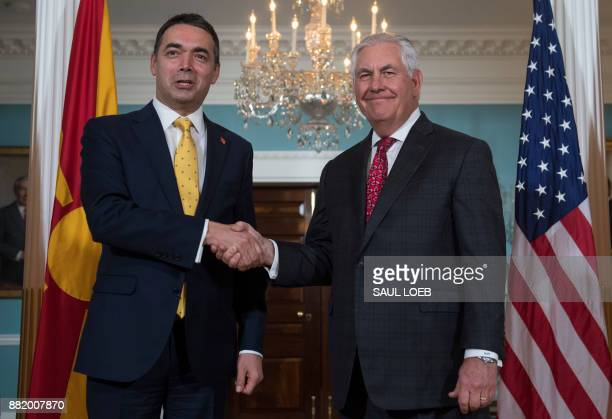 US Secretary of State Rex Tillerson shakes hands with Macedonian Foreign Minister Nikola Dimitrov prior to meetings at the State Department in...