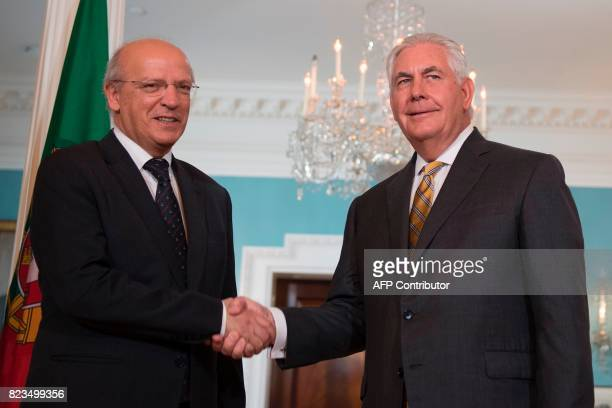 US Secretary of State Rex Tillerson shakes hands with Portuguese Foreign Minister Augusto Santos Silva at the State Department in Washington DC on...