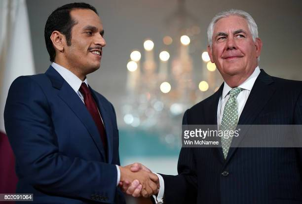 S Secretary of State Rex Tillerson shakes hands with Qatari Foreign Minister Sheikh Mohammed Bin Abdulrahman Al Thani prior to a scheduled meeting at...