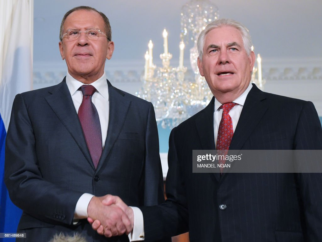 US Secretary of State Rex Tillerson shakes hands with Russian Foreign Minister Sergei Lavrov in the Treaty Room of the State Department in Washington, DC on May 10, 2017. /