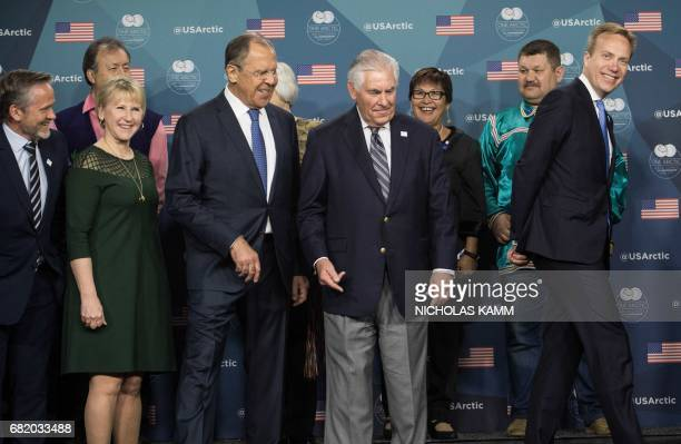 US Secretary of State Rex Tillerson shows the way out to Arctic Council foreign inisters Denmark's Anders Samuelso Sweden's Margot Wallstrom Russi's...