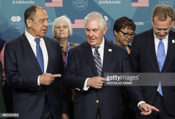 US Secretary of State Rex Tillerson shows the way out to Russian Foreign Minister Sergei Lavrov after posing for a family photo at the Arctic Council...