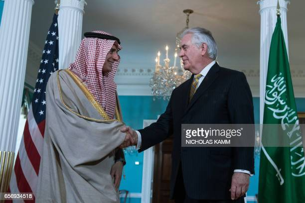 US Secretary of State Rex Tillerson speaks with Saudi Foreign Minister Adel alJubeir prior to a meeting at the State Department in Washington DC on...