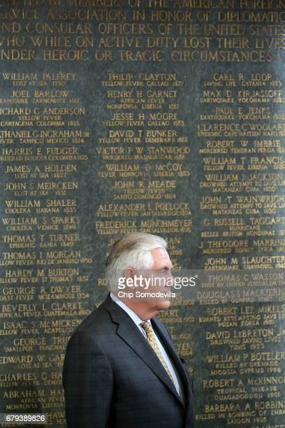 S Secretary of State Rex Tillerson stands next to the American Foreign Service Association Memorial Plaque during a ceremony on Foreign Affairs Day...