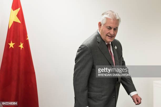 US Secretary of State Rex Tillerson takes his seat for a meeting with China's Foreign Minister Wang Yi on the sidelines of a gathering of Foreign...