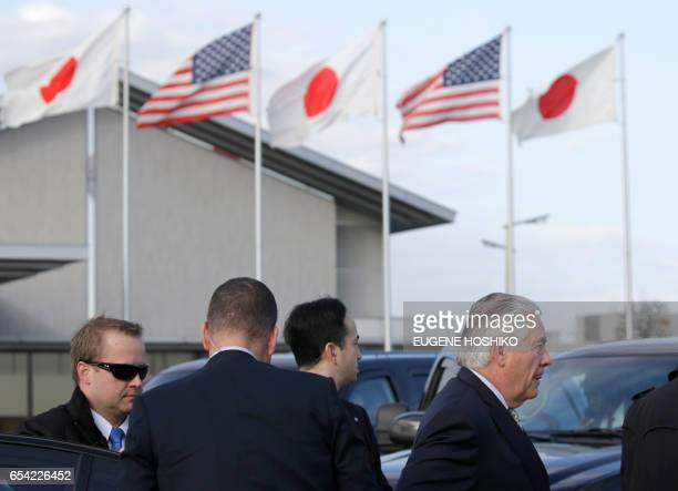 US Secretary of State Rex Tillerson walks to board his airplane before departure at Haneda International Airport in Tokyo on March 17 2017 / AFP...