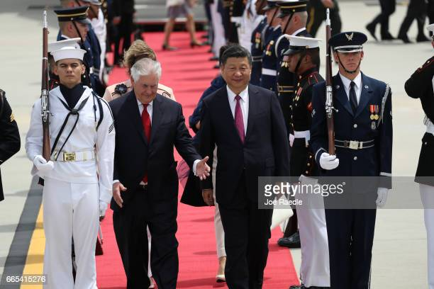 S Secretary of State Rex Tillerson walks with Chinese President Xi Jinping after he arrived at Palm Beach International Airport April 6 2017 in West...