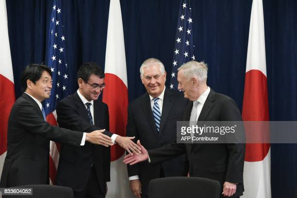 US Secretary of State Rex Tillerson watches as US Defense Secretary James Mattis shakes hands with Japan's Defense Minister Itsunori Onodera and...