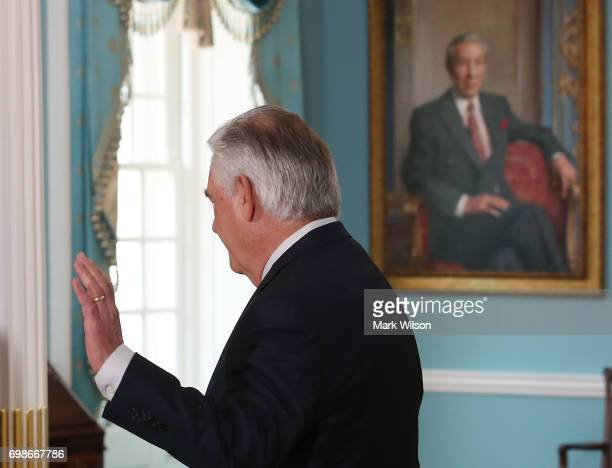 S Secretary of State Rex Tillerson waves off questions during a photo op with Ukrainian President Petro Poroshenko at the US State Department on June...