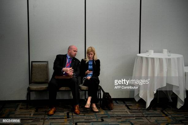 US Secretary of State Rex Tillerson's chief of staff Margaret Peterlin listens while he speaks to the press at the Hilton Midtown about an earlier...