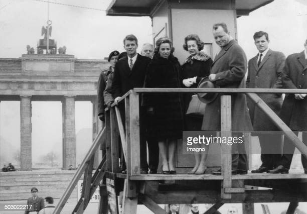 US Secretary of State Robert Kennedy on his tour through Berlin at the memorial for the victims of the Berlin Wall at the Brandenburg Gate Berlin 23...
