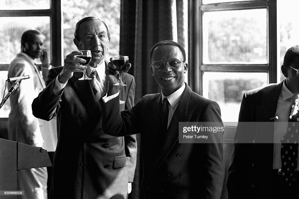 US Secretary of State Warren Christopher and Haitian President Jean-Bertrand Aristide raise their glasses in to toast the return to Haiti of Aristide, who had been in exile in the US. After initiating social and economic reform in 1991, a military coup, financed by Haiti's elite, ousted the president, who was only seven months into office.