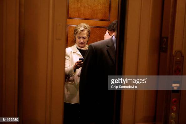 Secretary of Statedesignate and US Senator Hillary Clinton looks at her BlackBerry while on an elevator at the US Capitol January 7 2009 in...