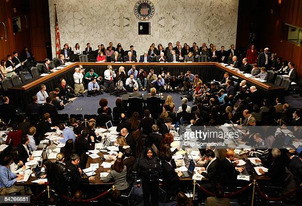 Secretary of Statedesignate and US Senator Hillary Clinton prepares to testify before a packed room during her confirmation hearing before the Senate...