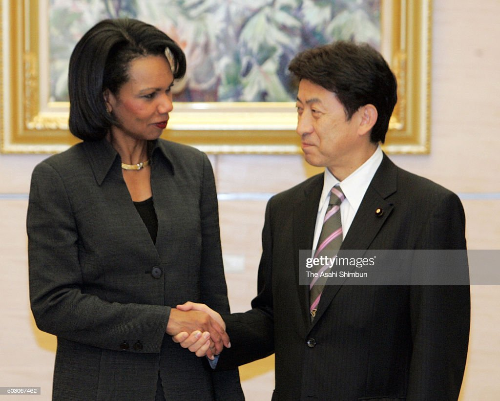 U.S. Secretary of States <a gi-track='captionPersonalityLinkClicked' href=/galleries/search?phrase=Condoleezza+Rice&family=editorial&specificpeople=157540 ng-click='$event.stopPropagation()'>Condoleezza Rice</a> (L) and Chief Cabinet Secretary Yasushisa Shiozaki (R) shake hands prior to their meeting at Prime Minister Shinzo Abe's official residence on October 18, 2006 in Tokyo, Japan.