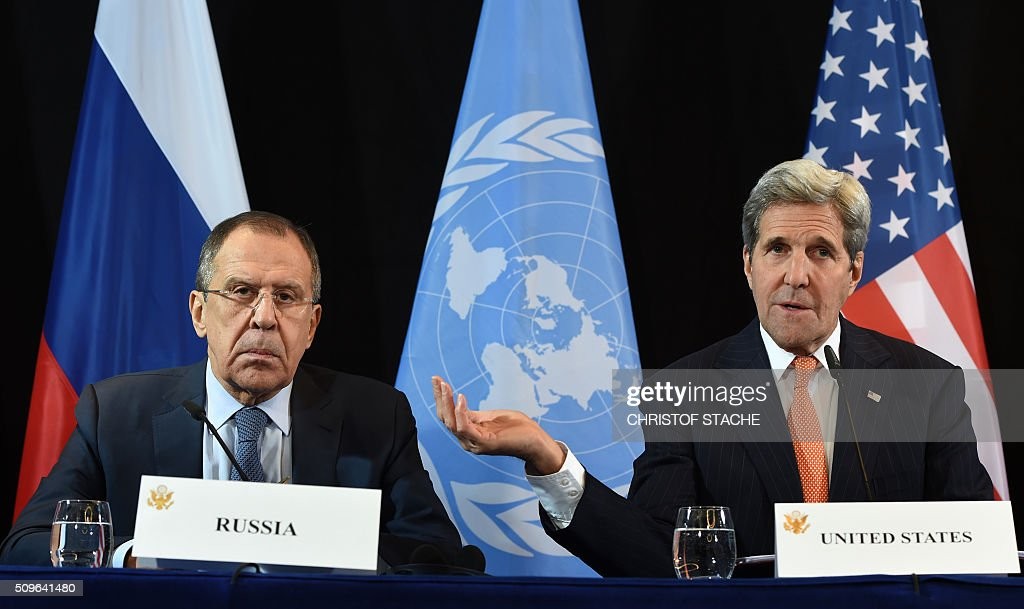 US Secretary of States John Kerry (R) gestures beside of Russian Foreign Minister Sergei Lavrov (L) during a news conference after the International Syria Support Group (ISSG) meeting in Munich on February 12, 2016. / AFP / Christof STACHE