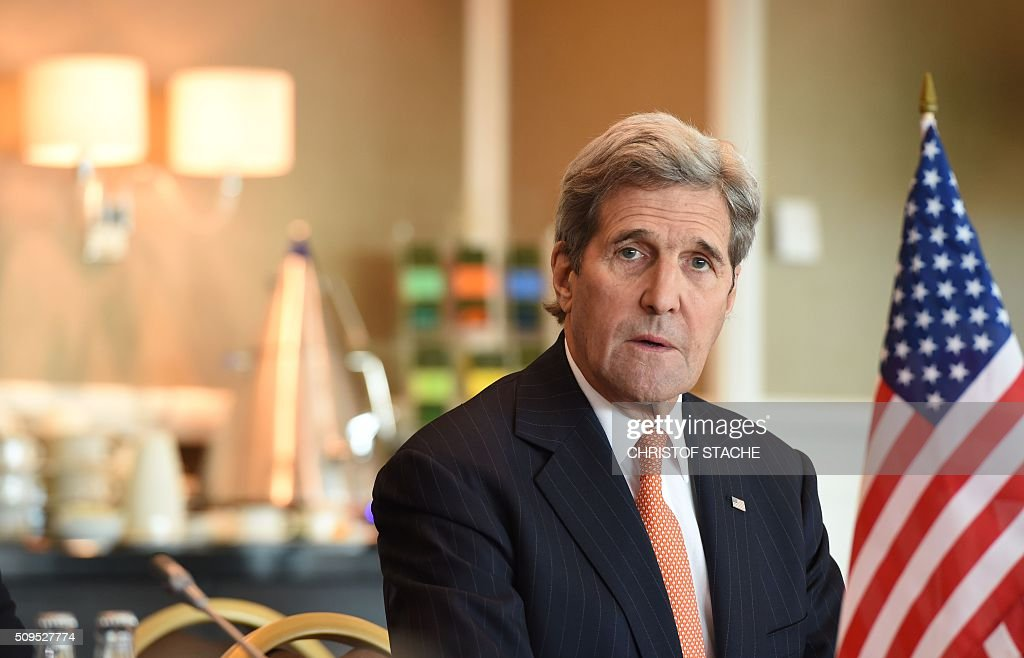 US Secretary of States John Kerry has taken seat for diplomatic talks with the Russian Foreign Minister on February 11, 2016 in Munich, southern Germany. Russia said it was ready to discuss a ceasefire in Syria as foreign ministers gathered in Munich in a bid to kick-start peace talks derailed by the regime onslaught on the besieged city of Aleppo. / AFP / Christof STACHE
