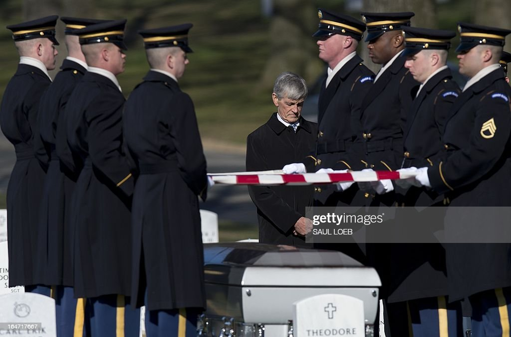US Secretary of the Army John McHugh (C) bows his head during a burial service for US Army Captain Andrew Pedersen-Keel in Section 60 at Arlington National Cemetery in Arlington, Virginia, March 27, 2013. Pedersen-Keel, 28, was killed March 11 during an attack on a police station in Afghanistan. AFP PHOTO / Saul LOEB