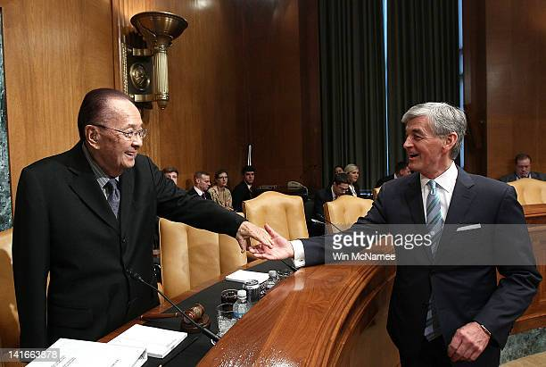 Secretary of the Army John McHugh greets Sen Daniel Inouye before a hearing of the Senate Appropriations Committee March 21 2012 in Washington DC...