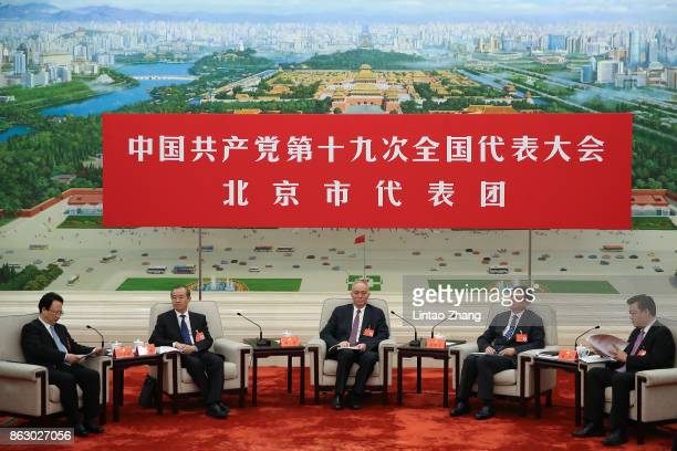 Secretary of the Beijing Municipal Party Committee Cai Qi with Chen Jining Mayor of Beijing attends a meeting of the 19th Communist Party Congress at...