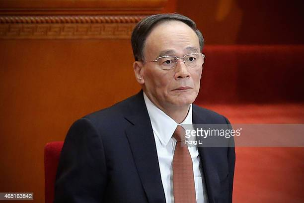 Secretary of the Central Commission for Discipline Inspection Wang Qishan attends the opening session of the Chinese People's Political Consultative...