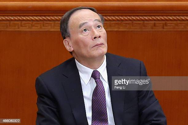 Secretary of the Central Commission for Discipline Inspection Wang Qishan attends the closing session of the Chinese People's Political Consultative...