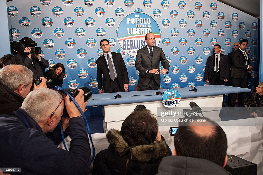 Secretary of the centre-right party PDL, Angelino Alfano (CR) and Daniele Capezzone, arrive for a press conference at the headquarters on February 25, 2013 in Rome, Italy. Election polls showed Pier Luigi Bersani's centre-left alliance to be a few points ahead of the centre-right bloc led by ex-Prime Minister Silvio Berlusconi and Movimento 5 Stelle (Five Stars Movement) to settle at the third place both at the Chamber of Deputies and at the Senate.