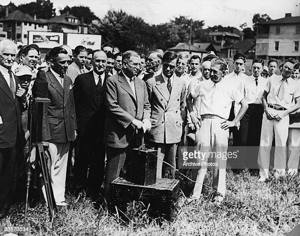 US Secretary of the Interior Harold L Ickes stands ready to detonate the first explosives to begin the demolition of some older buildings in Atlanta...