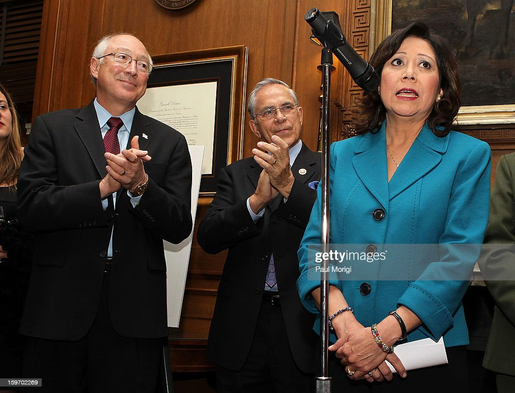 Secretary Of The Interior Ken Salazar (L) and Rep. Ruben Hinojosa (D-TX) look on as Secretary of Labor Hilda Solis makes a few remarks at a reception to recognize The National Park Service and The American Latino Initiative at the Secretary of the Interior's Suite at the Department of the Interior on January 18, 2013 in Washington, DC.