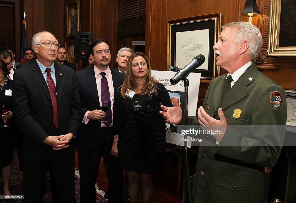 Secretary Of The Interior Ken Salazar (L) looks on as Jonathan B. Jarvis, Director of the U.S. National Park Service, makes a few remarks at a reception to recognize The National Park Service and The American Latino Initiative at the Secretary of the Interior's Suite at the Department of the Interior on January 18, 2013 in Washington, DC.