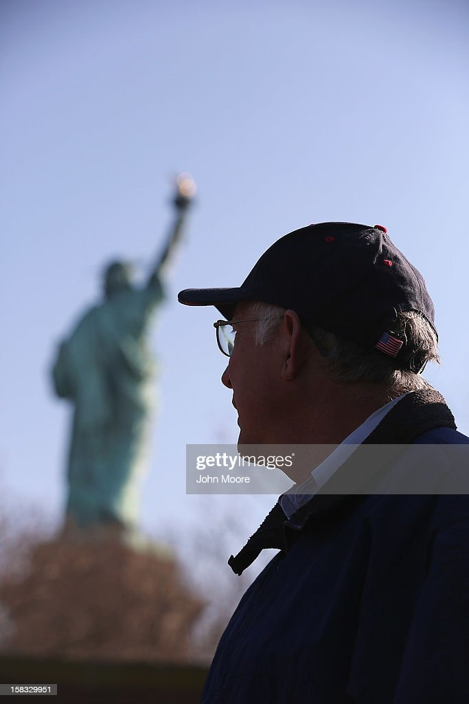 Secretary of the Interior Ken Salazar looks towards the Statue of Liberty which, remains closed to the public six weeks after Hurricane Sandy on December 13, 2012 in New York City. The storm caused extensive damage to National Park Service facilities on Liberty Island, although the statue itself remained unscathed. according to Salazar.