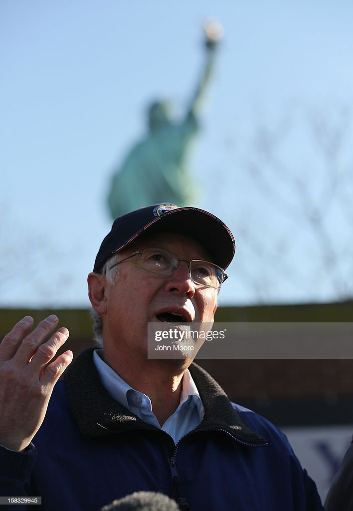 U.S. Secretary of the Interior Ken Salazar speaks to the media in front of the Statue of Liberty which, remains closed to the public six weeks after Hurricane Sandy on December 13, 2012 in New York City. The storm caused extensive damage to National Park Service facilities on Liberty Island, although the statue itself remained unscathed. Salazar toured the island Thursday while visiting the area to see damage caused by the storm.