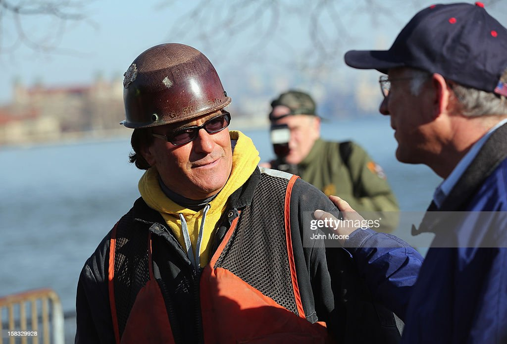 U.S. Secretary of the Interior Ken Salazar (R), speaks with electrician John Stivaly while inspecting damage to the grounds of the Statue of Liberty which, remains closed to the public six weeks after Hurricane Sandy on December 13, 2012 in New York City. The storm caused extensive damage to National Park Service facilities on Liberty Island, although the statue itself remained unscathed. Salazar toured the island Thursday while visiting the area to see damage caused by the storm.