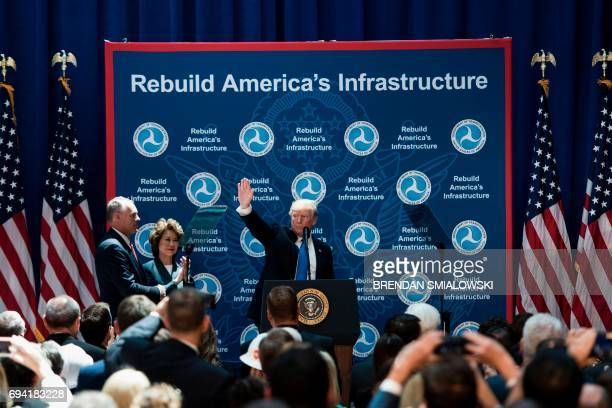Secretary of the Interior Ryan Zinke and US Secretary of Transportation Elaine Chao watch US President Donald Trump speaks wave during his visit to...