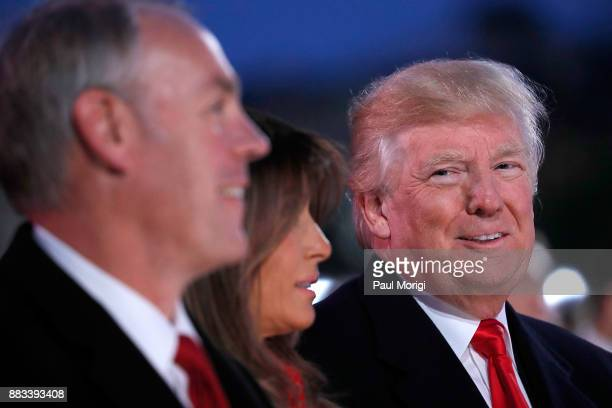 US Secretary of the Interior Ryan Zinke First Lady Melania Trump and US President Donald Trump attend the 95th Annual National Christmas Tree...