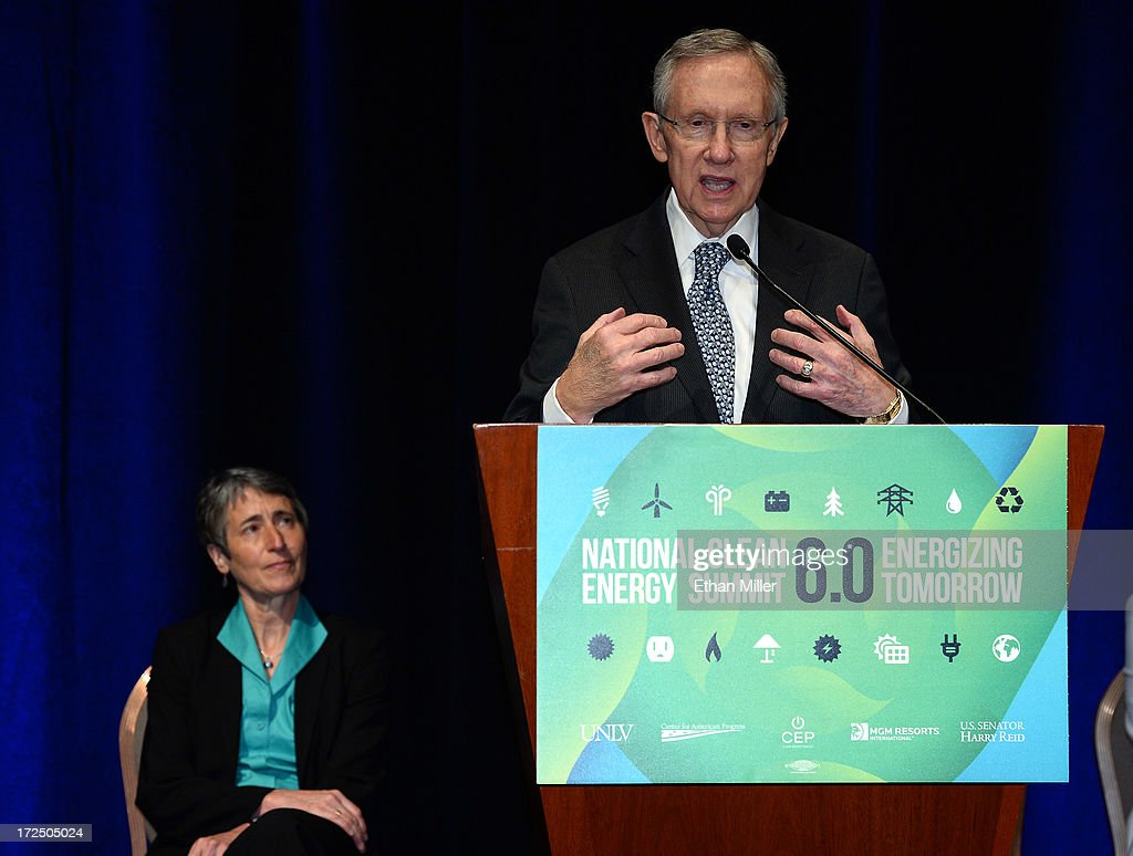 U.S. Secretary of the Interior Sally Jewell (L) looks on as U.S. Senate Majority Leader <a gi-track='captionPersonalityLinkClicked' href=/galleries/search?phrase=Harry+Reid+-+Politician&family=editorial&specificpeople=203136 ng-click='$event.stopPropagation()'>Harry Reid</a> (D-NV) speaks at a news conference at the Mandalay Bay Convention Center announcing MGM Resorts International's planned installation of the world's second largest rooftop solar photovoltaic array on July 2, 2013 in Las Vegas, Nevada. The 6.2-megawatt array will use 20,000 solar panels to cover about 20 acres of the convention center's roof and will provide 20 percent of the resort's energy needs. It was also announced that the National Clean Energy Summit 6.0 will be held at the resort on August 13, 2013, and will focus on the future of clean energy.