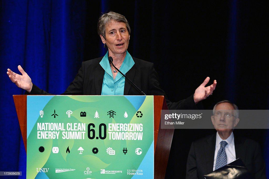U.S. Secretary of the Interior Sally Jewell (L) speaks as U.S. Senate Majority Leader <a gi-track='captionPersonalityLinkClicked' href=/galleries/search?phrase=Harry+Reid+-+Politician&family=editorial&specificpeople=203136 ng-click='$event.stopPropagation()'>Harry Reid</a> (D-NV) looks at a news conference at the Mandalay Bay Convention Center announcing MGM Resorts International's planned installation of the world's second largest rooftop solar photovoltaic array on July 2, 2013 in Las Vegas, Nevada. The 6.2-megawatt array will use 20,000 solar panels to cover about 20 acres of the convention center's roof and will provide 20 percent of the resort's energy needs. It was also announced that the National Clean Energy Summit 6.0 will be held at the resort on August 13, 2013, and will focus on the future of clean energy.