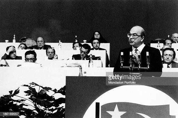Secretary of the Italian Socialist Party Bettino Craxi giving a speech at a congress of Italian Communist Party On the left Secretary of Italian...