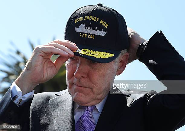 S secretary of the Navy Ray Mabus puts on a hat for the new USNS Harvey Milk during a ship naming ceremony on August 16 2016 in San Francisco...