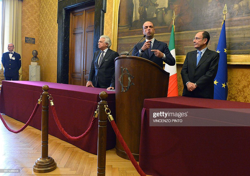 Secretary of the People of Freedom (PDL) party Angelino Alfano (C) gestures as he gives a speech, flanked by former president of the Republic Senate Renato Schifani (R) and Denis Verdini, on April 25, 2013 in Rome, during a meeting with designated Prime Minister Enrico Letta.