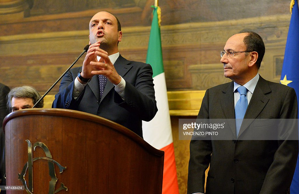 Secretary of the People of Freedom (PDL) party Italy's Angelino Alfano (L) gives a speech flanked by former president of the Republic Senate Renato Schifani on April 25, 2013 in Rome, during a meeting with designated Prime Minister Enrico Letta.