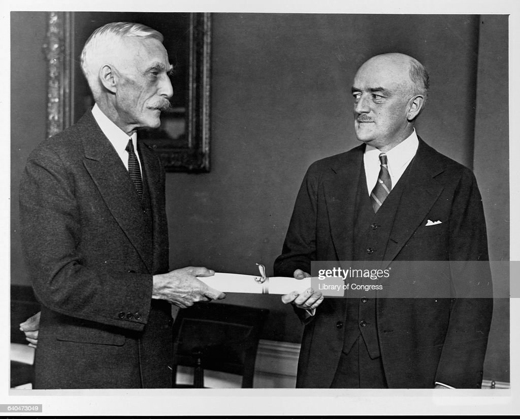Secretary of the Treasury <a gi-track='captionPersonalityLinkClicked' href=/galleries/search?phrase=Andrew+Mellon&family=editorial&specificpeople=908430 ng-click='$event.stopPropagation()'>Andrew Mellon</a> (left) hands Walter E. Hope his commission after Hope's induction ceremony as Assistant Secretary of the Treasury.