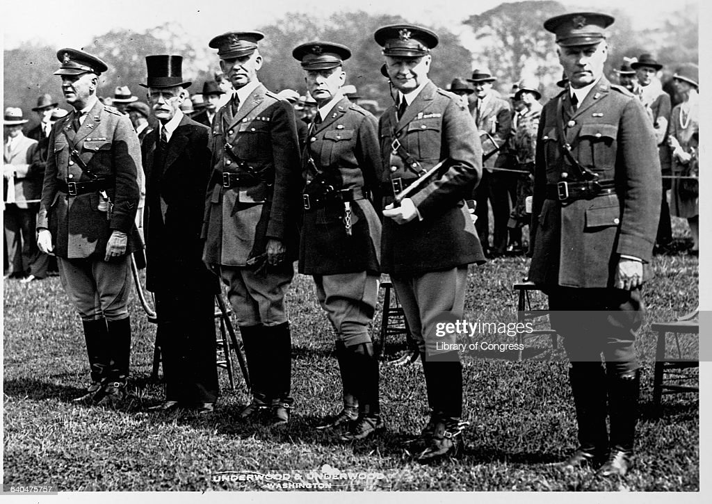 Secretary of the Treasury <a gi-track='captionPersonalityLinkClicked' href=/galleries/search?phrase=Andrew+Mellon&family=editorial&specificpeople=908430 ng-click='$event.stopPropagation()'>Andrew Mellon</a> reviews a parade of troops with a group of officers on the Washington Monument grounds. Washington D. C., May 4, 1928.