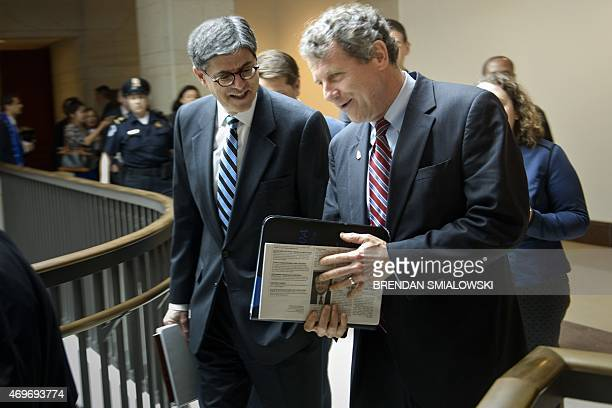 US Secretary of the Treasury Jacob Lew walks with Senator Sherrod Brown to a meeting with Senate Democrats on Capitol Hill April 14 2015 in...